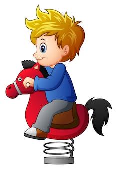 Ilustração em vetor de garotinho no cavalo de balanço