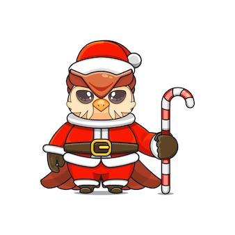 Ilustração em vetor de mascote de coruja monstro fofa vestindo fantasia de papai noel segurando um bastão de doces
