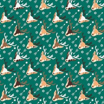 Ilustração em vetor de padrão de natal com cabeças de renas e enfeites