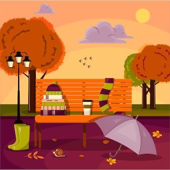 Ilustração em vetor de um parque de outono um banco com livros, um lenço e folhas amarelas projeto liso