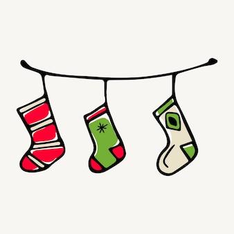 Ilustração em vetor doodle isolado de meias de natal para presentes pendurados na lareira.