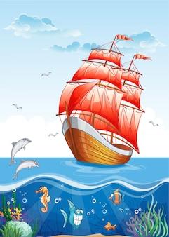 Ilustração infantil de um veleiro com velas vermelhas e o mundo subaquático.