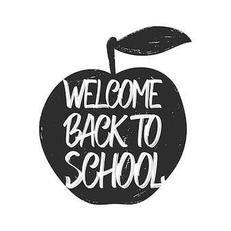 Ilustração vectro: letras desenhadas à mão de bem-vindo de volta à escola e maçã no fundo branco
