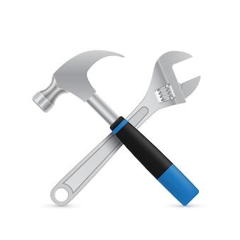 Imagem de martelo industrial cruzado e chave inglesa