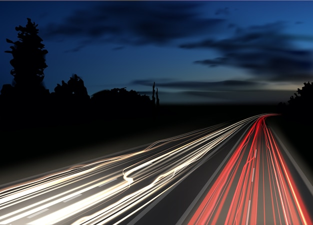 Imagem de trilhas de luz coloridas com efeito de desfoque de movimento de longa exposição