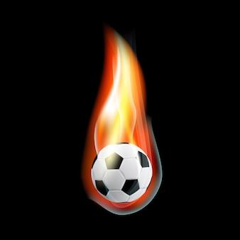 Imagem de uma bola de futebol queimando em fundo preto