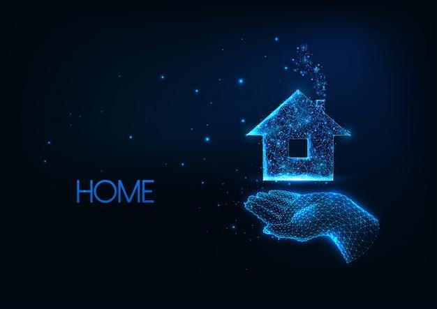 Imobiliário futurista, conceito de compra de casa com brilho baixo poli mão segurando o edifício residencial