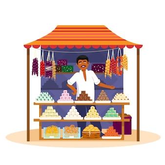 Indiano vendendo doces asiáticos tradicionais