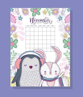 Informações de calendário de novembro com pinguim e coelho
