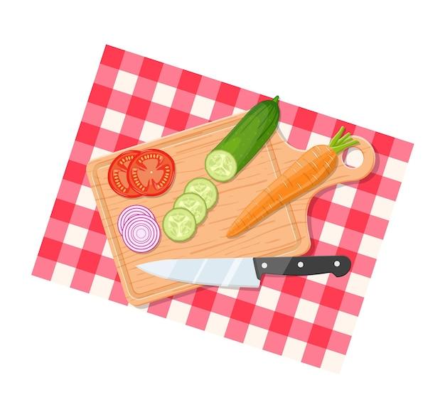 Ingredientes da salada na tábua com faca. legumes na mesa para salada. legumes para misturar salada.