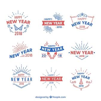 Insígnias simples do ano novo em vermelho e azul