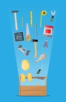 Instrumentos de carpintaria em caixa de ferramentas de madeira
