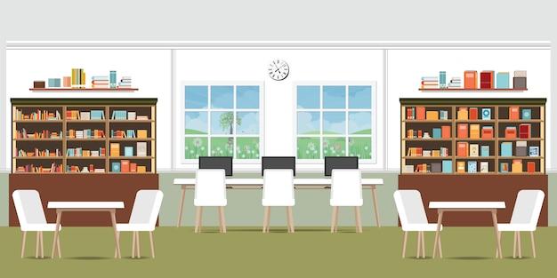 Interior da biblioteca moderna com estantes.