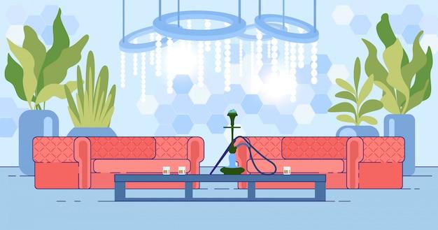 Interior da boate com sofá e cachimbo de água na mesa