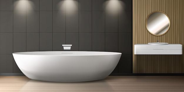Interior do banheiro com banheira, pia e espelho redondo