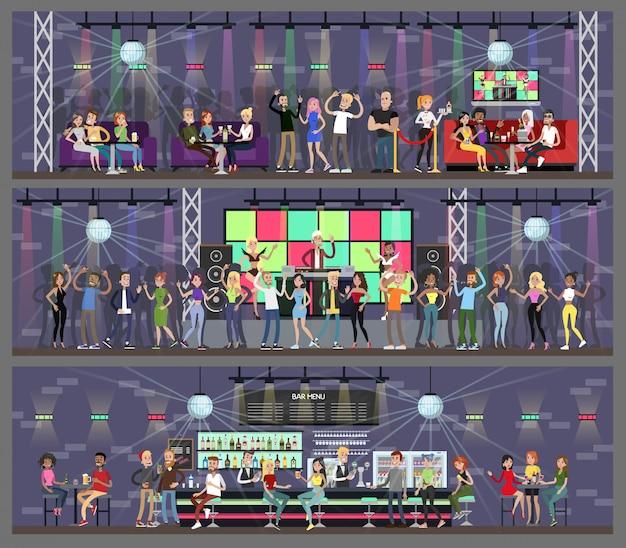Interior do clube noturno conjunto com pessoas dançando e bebendo.
