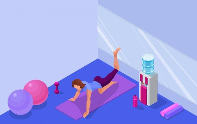Interior do estúdio de ioga com mulher fazendo exercícios de fitness