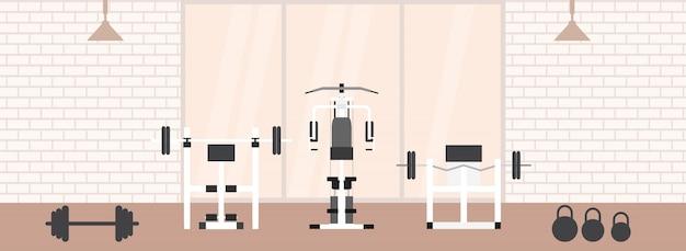 Interior do ginásio de fitness com equipamentos desportivos e equipamentos de cardio, bicicleta ergométrica, esteiras, elípticos,. conceito de fitness com clube de esporte em estilo simples