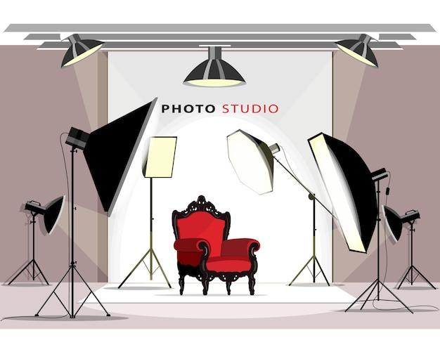 Interior moderno do estúdio fotográfico com equipamento de iluminação e poltrona.