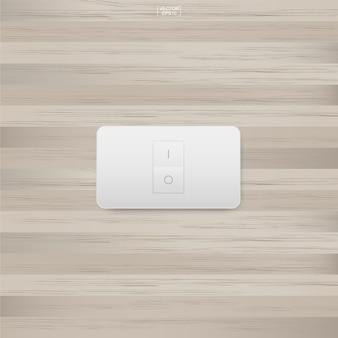 Interruptor de luz na madeira.
