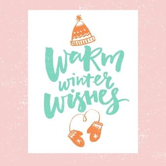 Inverno quente deseja design de cartão de natal tipografia vetorial com ilustrações de chapéu e luvas Vetor Premium