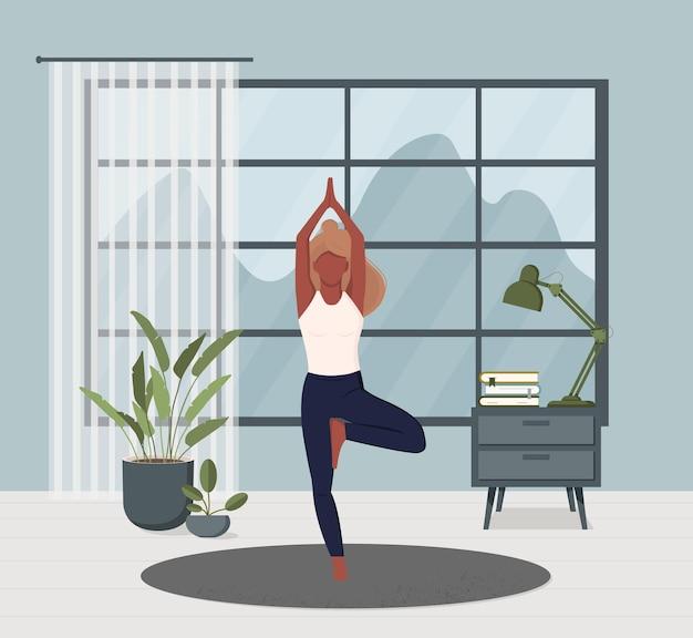Ioga em casa. meditação. esportes. menina realiza exercícios aeróbicos e meditação matinal em casa.