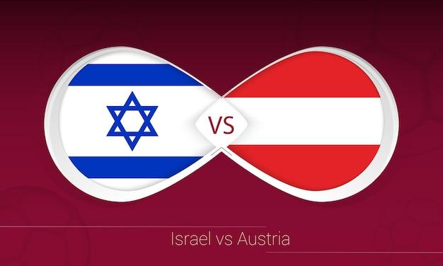 Israel vs áustria em competição de futebol, ícone do grupo f. versus no fundo do futebol.