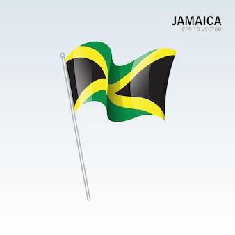 Jamaica agitando bandeira isolada em cinza