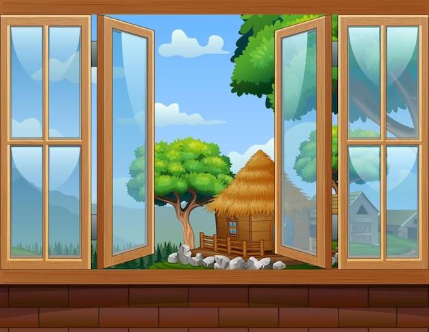 Janela aberta com uma paisagem rural