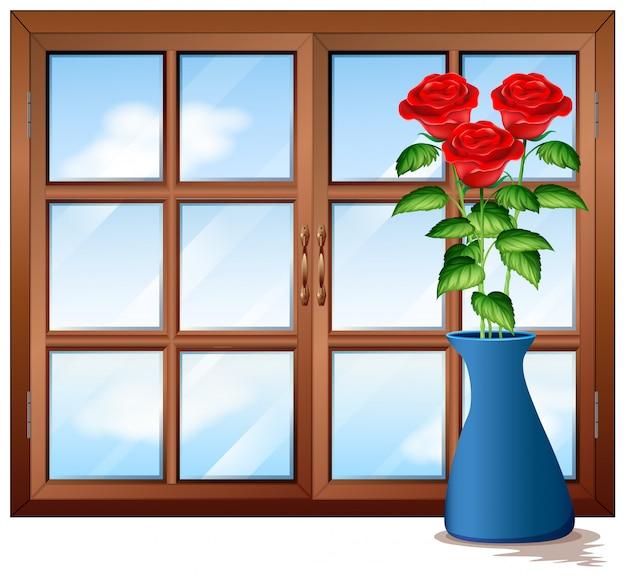 Janela com rosas em vaso
