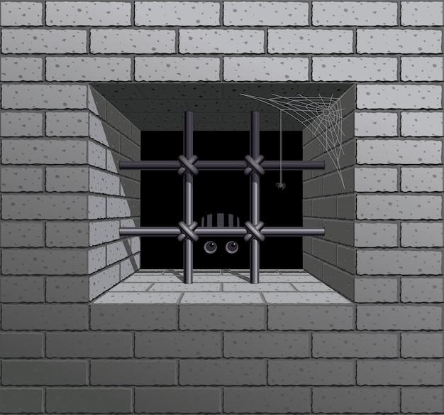 Janela gradeada na parede de tijolos