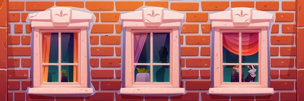 Janelas da casa ou castelo, fachada de parede de tijolo