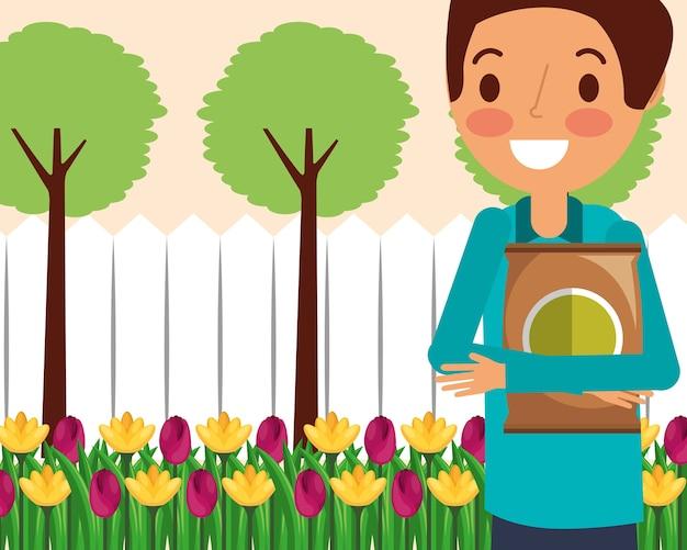 Jardineiro homem segurando fertilizante cama de flores
