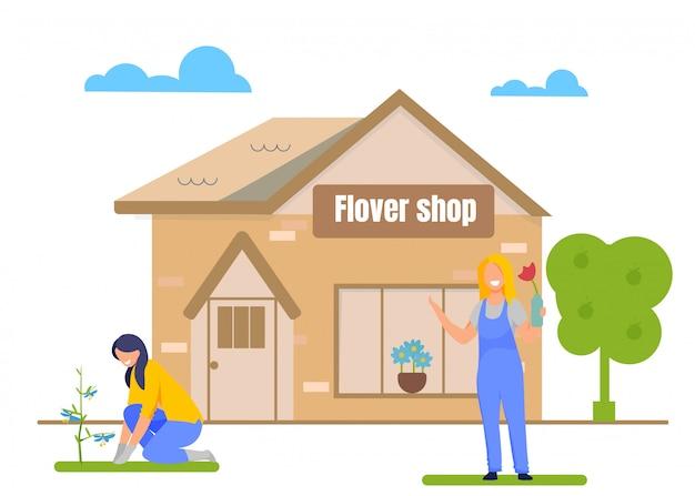 Jardineiros plantando flores na frente da loja de flores