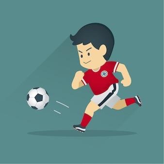 Jogador de futebol chutando uma bola