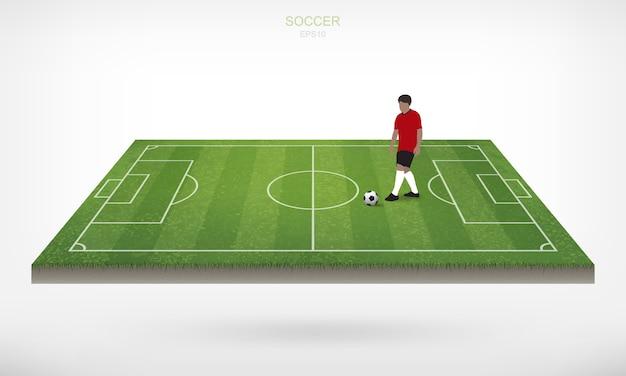 Jogador de futebol e bola do futebol do futebol na área do campo de futebol com fundo branco.