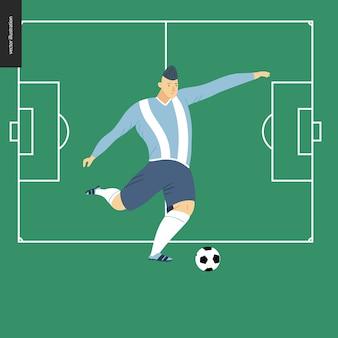 Jogador de futebol europeu de futebol chutando uma bola de futebol no campo de futebol verde