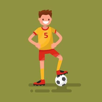 Jogador de futebol sorridente em pé com uma ilustração de bola