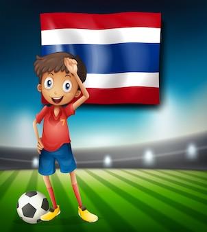 Jogador de futebol tailandês no estádio