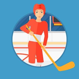 Jogador de hóquei no gelo com vara.