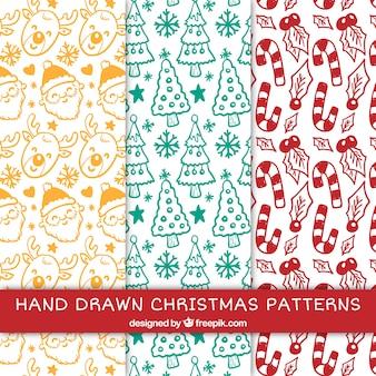 Jogo da mão desenhada padrões natal agradáveis