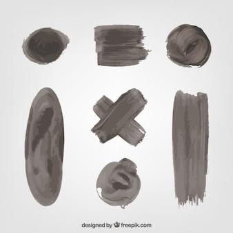 Jogo das manchas de tinta preta e pinceladas
