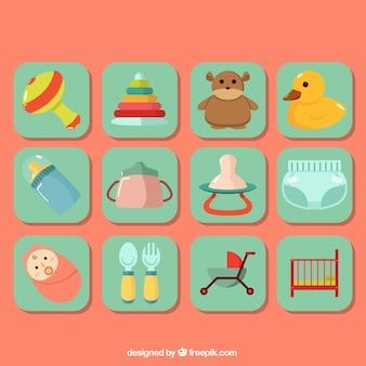 Jogo de artigos coloridos do bebê no design plano