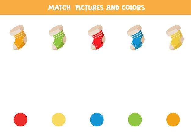 Jogo de correspondência de cores com meias de desenho animado para o natal. jogo lógico para crianças.
