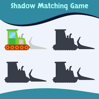 Jogo de correspondência de sombras - edição de bulldozer - vetor premium bom para educação e coleta de crianças