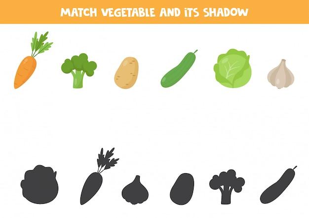 Jogo de correspondência para crianças. legumes e suas sombras.