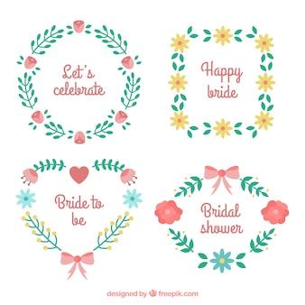 Jogo de quatro frames florais do casamento no design plano