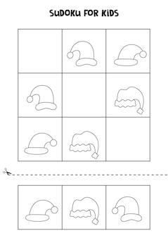 Jogo de sudoku para crianças com chapéus de papai noel em preto e branco.