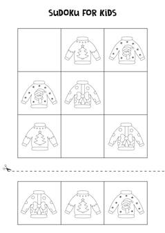 Jogo de sudoku para crianças com suéteres de natal em preto e branco.