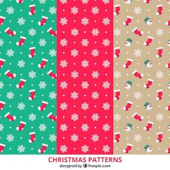 Jogo de três padrões de natal com flocos de neve e meias